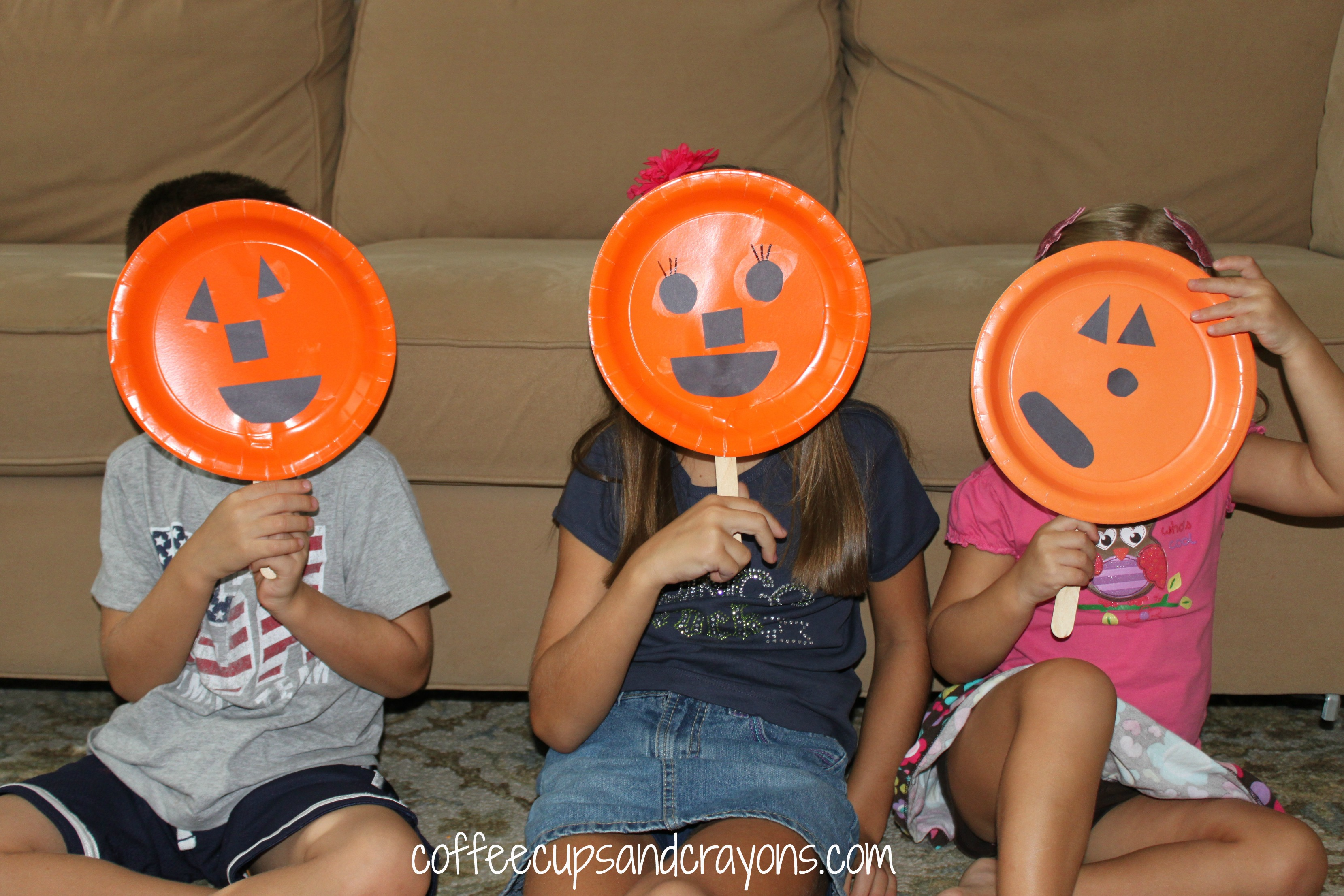 pumpkin face puppet and halloween finger play coffee cups and